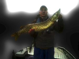 Geoff with a lovely marked fish which shows up despite the somewhat dodgy photo!