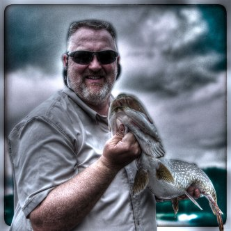 Eamonn with part of a superb days Pike fishing haul.